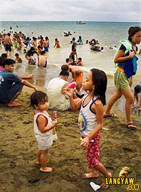 Beach revelers during Easter Sunday in Talisay City, Cebu
