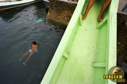 Children enjoying a dip at Danao's fish wharf.