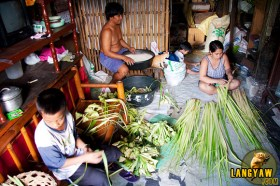 A typical morning's preparation at a V Rama household where puso making is the major source of income.
