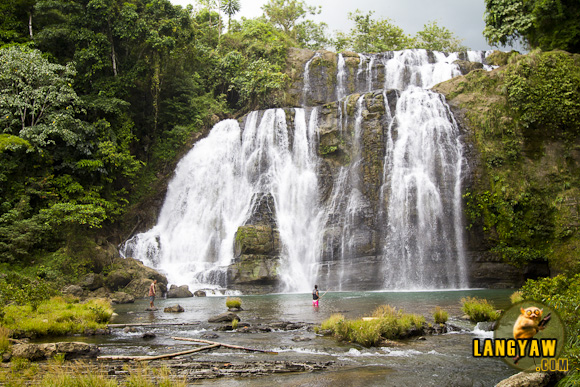Beautiful Situbo Falls in Tampilisan, Zamboanga del Norte dwarfs two men at the bottom