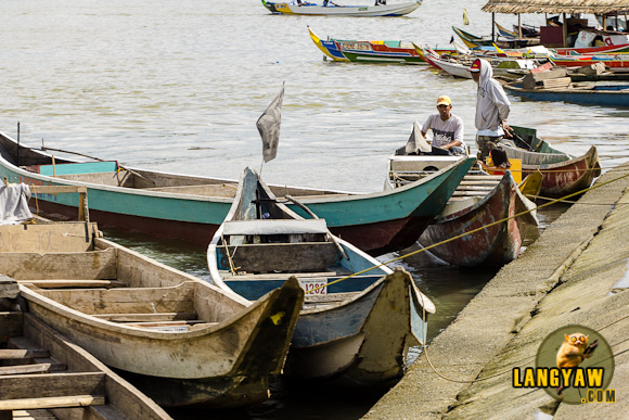 Motorized pumpboats awaiting passengers to ferry them acros or into the nearby surrounding villages