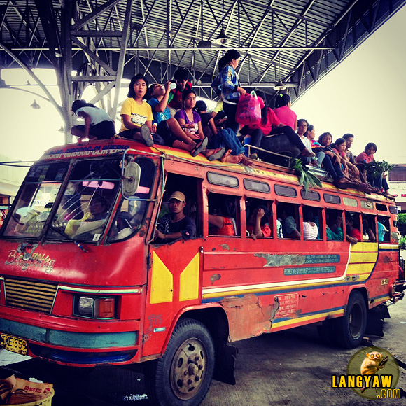 Filled to the roof, passengers cram and position themselves