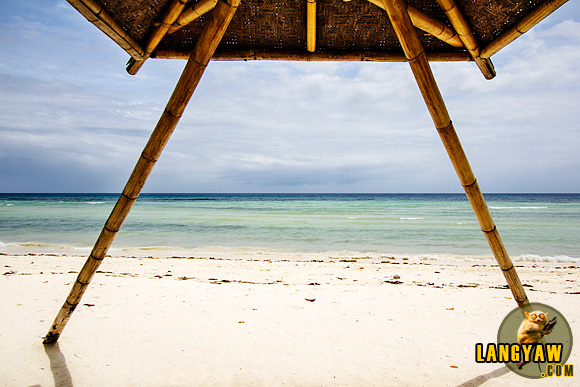 Differently designed hut opening to the beautiful Quinale Beach