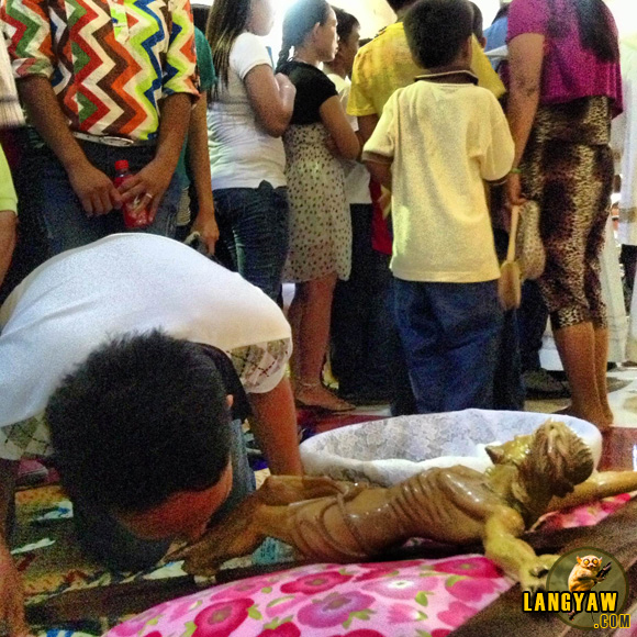 After the 3PM ritual on Good Friday, folks line up to kiss and pay homage to the crucified Christ