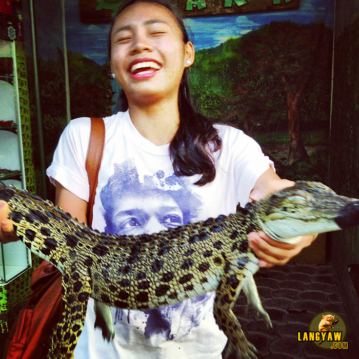Angeli with a baby croc at the Davao Crocodile Park