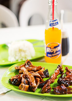 Grilled liempo and pork barbeque with softdrink and rice for dinner