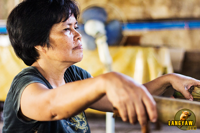 Rose Enjambre-Inoc, 55 years old has worked for the past 40 years roasting lechon and has supported her family thru this business