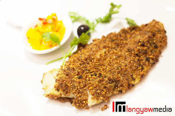 Herb encrusted fish with lemon and mango salsa