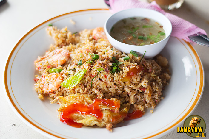 Nasi kandar salam with its mint sauce, a piece of fried chicken and rice fried with tomatoes, tomato sauce, sugar and chili