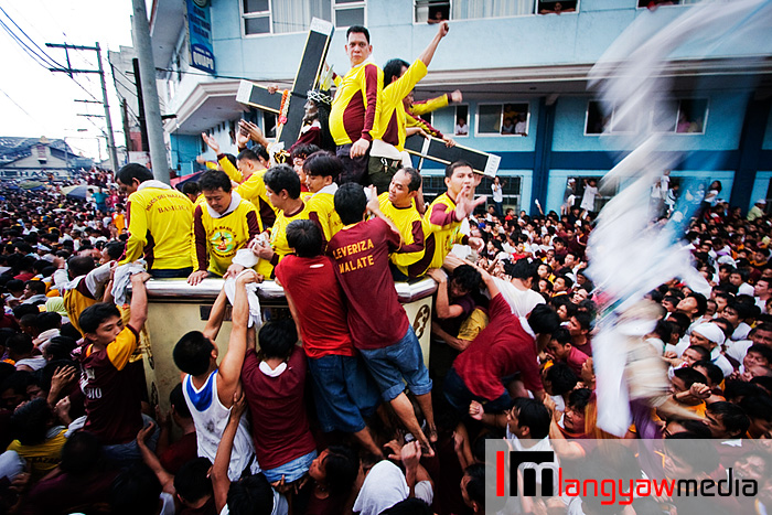 The Black Nazarene on its carroza. A devotee's towel is thrown in to be wiped on the image and thrown back
