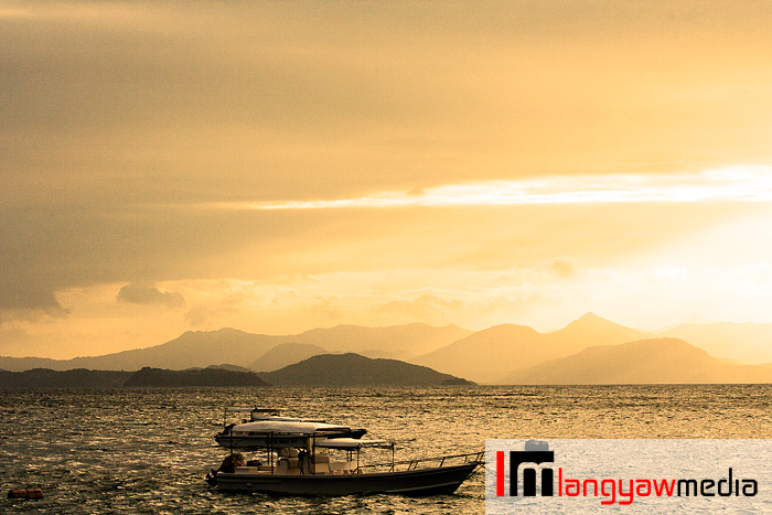 Sunset at Flower Islan with a view of the rugged terrain of northern Palawan