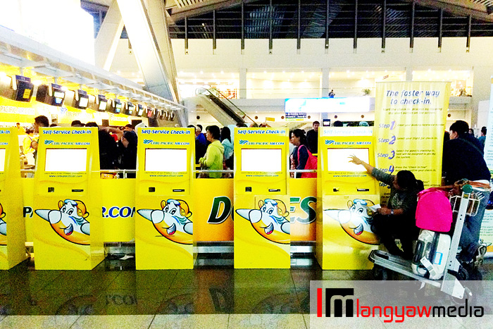 Just some of the 16 self service kiosks at Terminal 3
