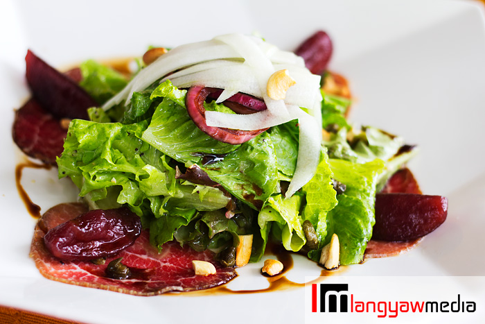It was a medley of wonderful flavors that played out while having the Bresaola of Beef: poached pears, field greens, crispy capers, caramelized balsamic red onion and cracked black pepper
