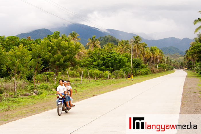 A habal-habal plies the highway in Gov. Generoso in Davao Oriental with the newly inscribed UNESCO World Heritage Site, Mt. Hamiguitan Range Wildlife Sanctuary