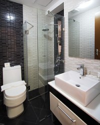 The unit's contemporary toilet and bath