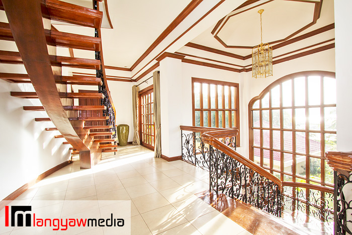 Second floor of mansion with the stairs leading to the penthouse