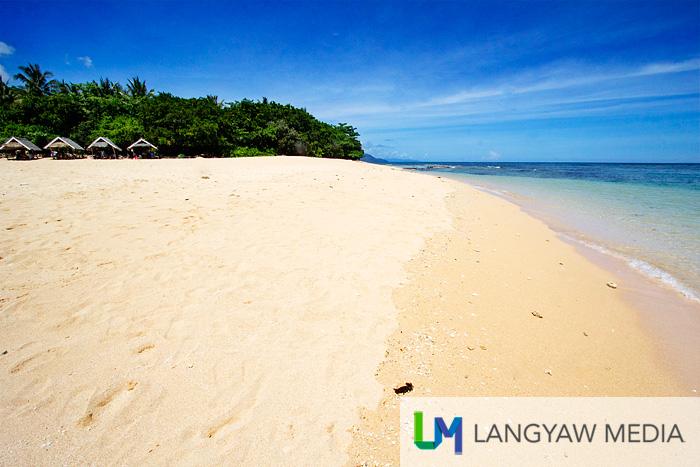 Blue skies, creamy white sand, azure waters...