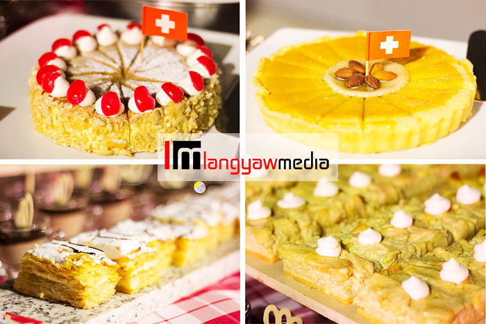 Different kinds of desserts: clockwise from top right: a dessert flan, a dessert with apples, cremeschnitte am meter (akin to the napoleones), and zucher kirschtorte,