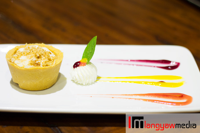Maja blanca cheesecake with rosquillos biscuits and puree of blueberry, mango and strawberry