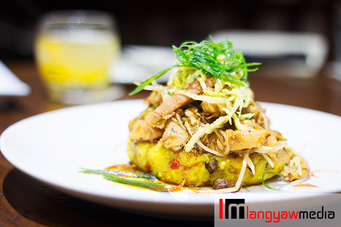 Bringhe, a sticky rice dish that is popular in Luzon and has affinities with the paella and Ilonggo's Arroz a valenciana