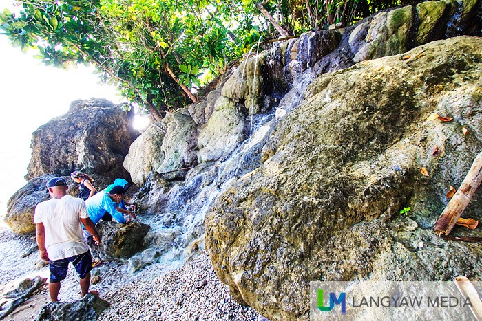 Enjoy the cool and fresh water spring emptying into the sea