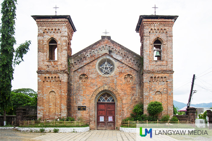 The turn of the century brick cemetery chapel and now, the Shrine of San Lorenzo Ruiz in Bangued