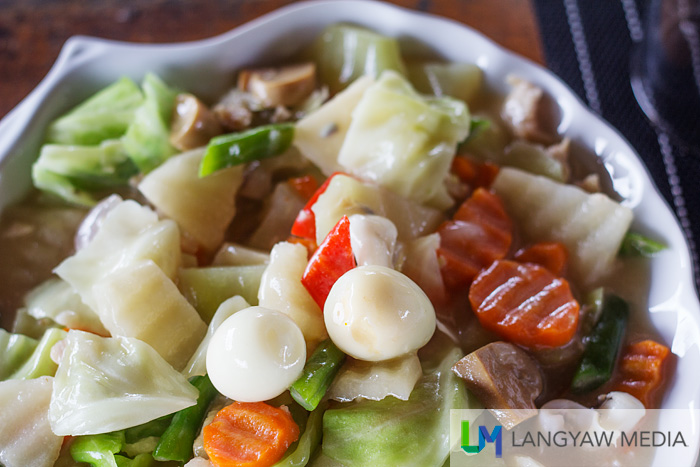 A medley of vegetables, meat and quail's eggs in chop suey
