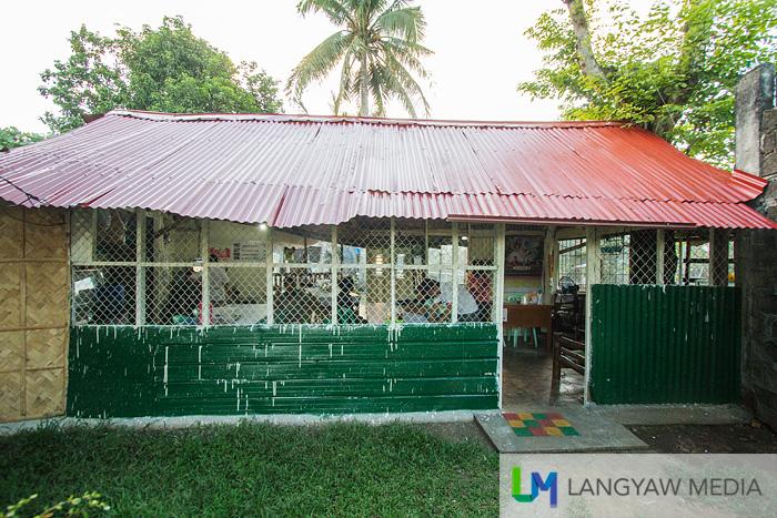 The humble shack of Cha Ced Kinalasan just along the river and near the Basilica