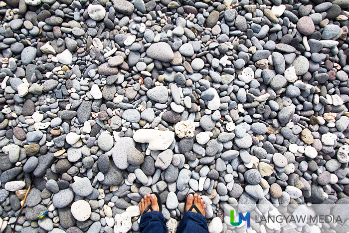 Those smooth round pebbles (or stones) with my feet to scale