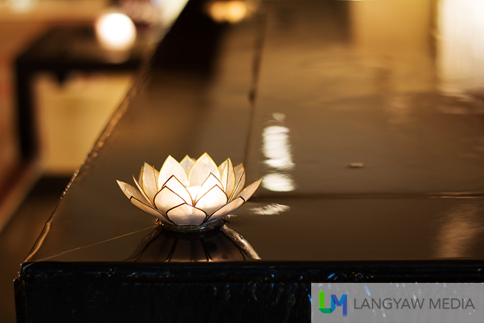 A shell crafted decor in the form of a lotus in the spa's zenlike fountain