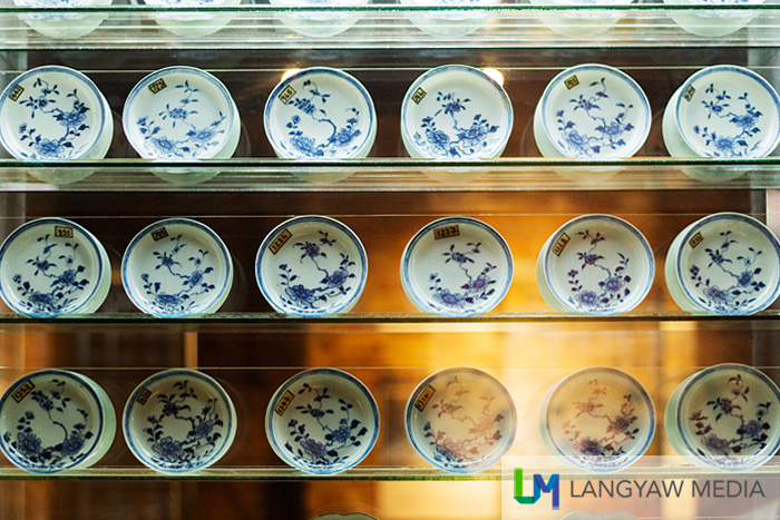 Porcelain plates displayed neatly in rows as recovered from the Griffin