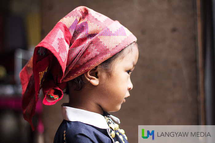 A Yakan seputangan cloth with its beautiful geometric patterns used as it is intended to be worn