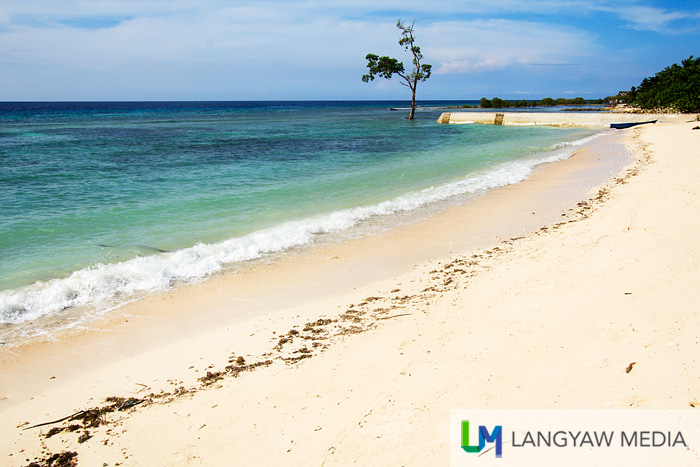 Almari Beach Resort's inviting white strip of beach