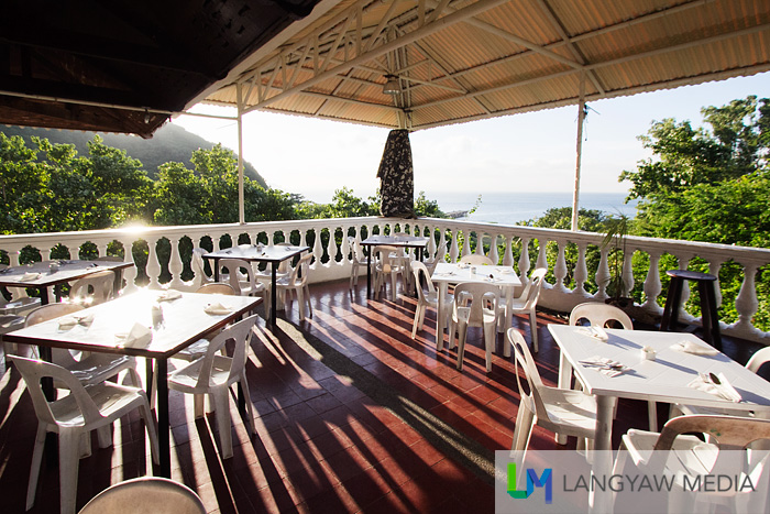 Corregidor inn's al fresco dining area early in the morning with beautiful views of both sides of the island's South Beach and main wharf