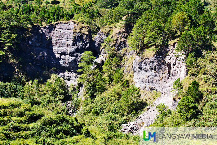 A beautiful rock face in Barangay Madongo. The hole in the rock is where a water runs out but dries up during the summer season.