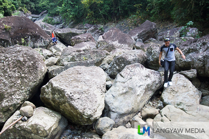 One has to jump or climb over these boulders to reach the series of cascades
