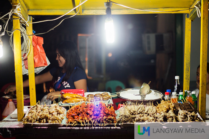 A barbecue food stall at night