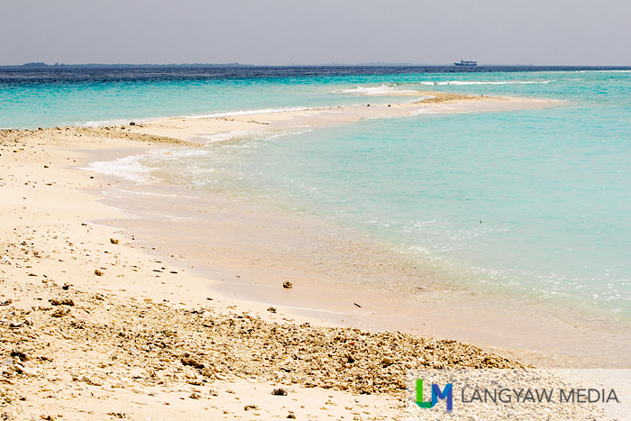The long snake like sandbar as seen from the isand