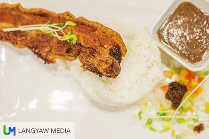Really good lechon kawali with scallions, alfalfa sprouts, tomatoes and bagoong as sidings