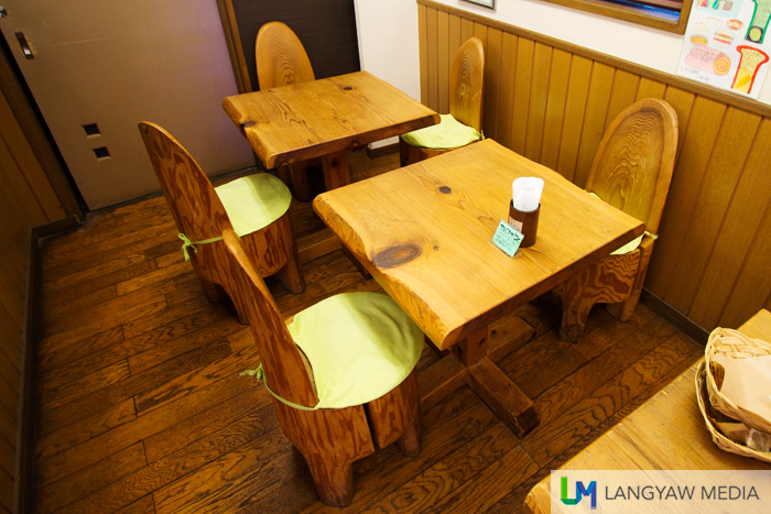 Small wooden chairs and tables