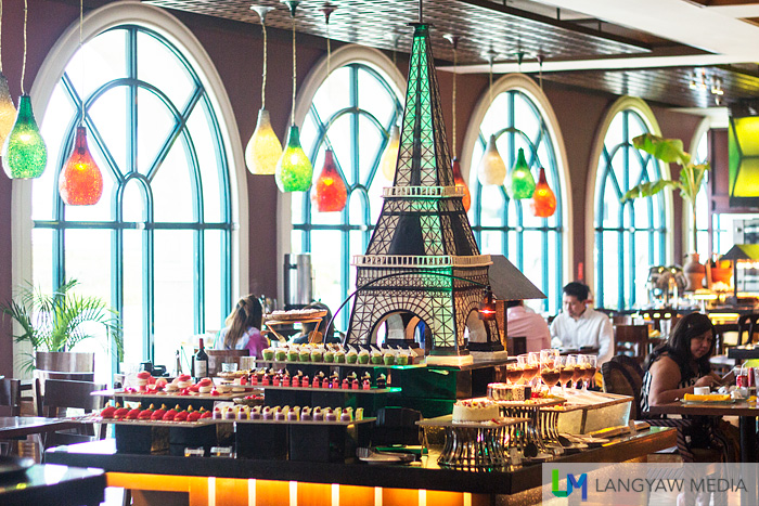 The dessert station with a huge Eiffel Tower replica