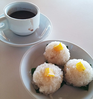 Puto maya with sikwate (steamed sticky rice with mango bits paired with thick hot chocolate)