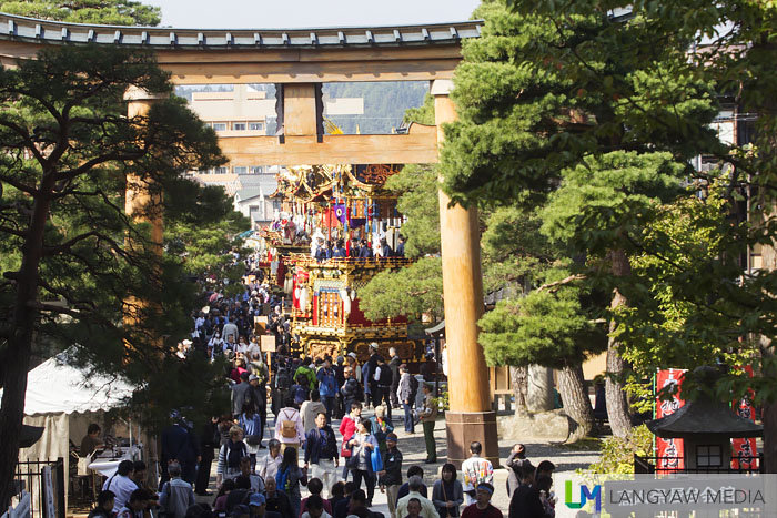 The view from the steps of the Sakurayama Hachimangu Shrine where beyond the torii gate are the ten colorful yatais which are processional structures
