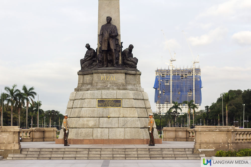 Rizal Monument with the controversial DMCI building