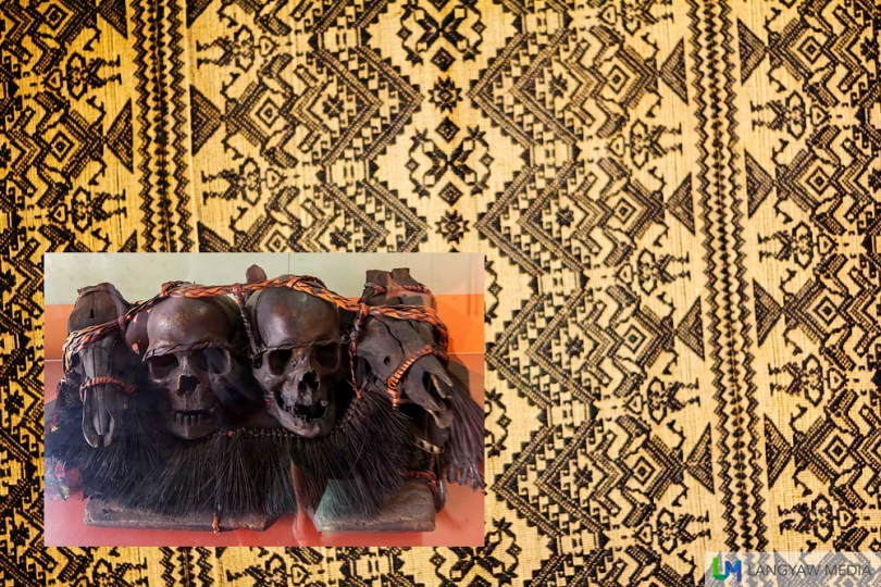 Traditional textile of one of the tribes in the Cordilleras. Inset, preserved skulls of men and an animal.
