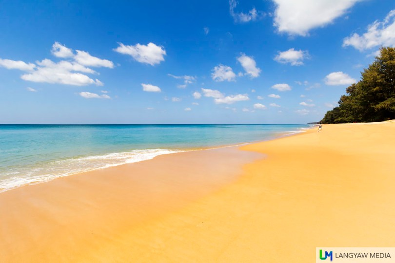 Golden sand, blue sky and the sea facing the Andaman