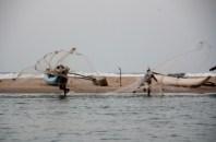 Fishermen throw nets, Batticaloa lagoon