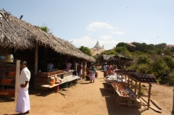 Stalls line the way from Kirinda temple