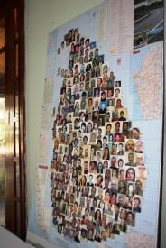 Volunteer passport photos fill a map of Sri Lanka