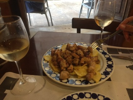 Excellent Ribeiro white wine and a Galician dish called Raxo. So good!